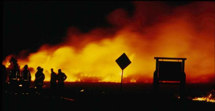 firefighters in night fire 725x373